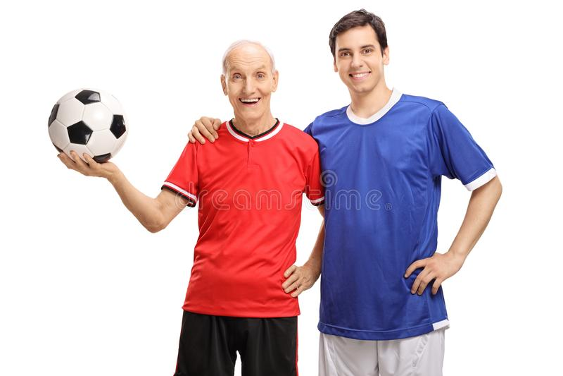 老足球运动员和一位年轻足球运动员 库存图片