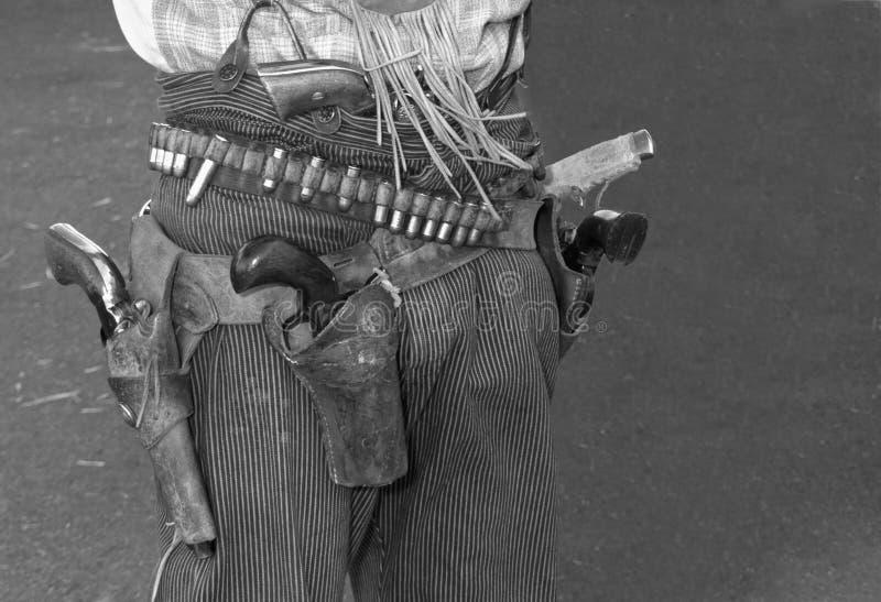 狂放的西部罪犯牛仔枪和手枪皮套 免版税库存图片