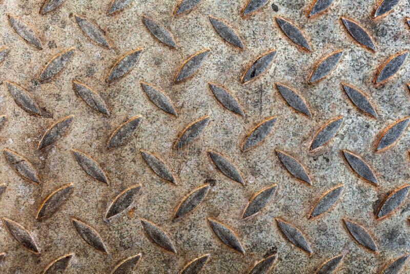 老金刚石板材样式,金属地板 库存图片