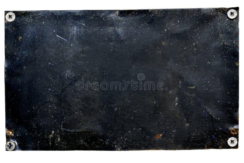 老金属门板绘与黑油漆 免版税库存照片
