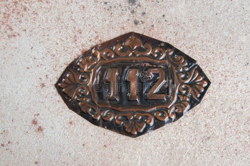 老铜家庭数字标志 免版税库存图片