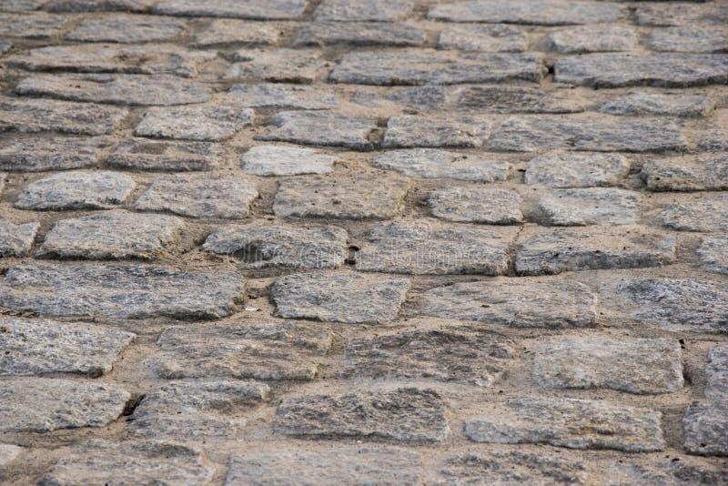 老铺路石,路面照片的小径关闭 库存照片