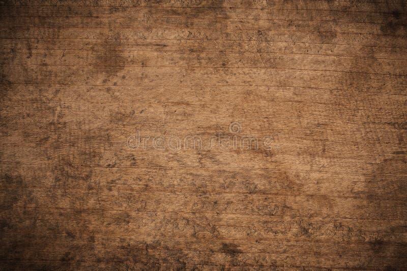 老难看的东西黑暗的织地不很细木背景,老棕色木纹理的表面,顶视图棕色木铣板 免版税图库摄影
