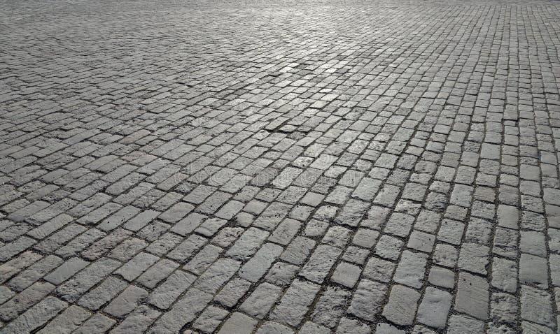 老鹅卵石路面抽象背景 库存照片