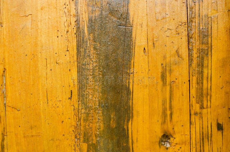老黄色被绘的木板条背景纹理 免版税库存照片