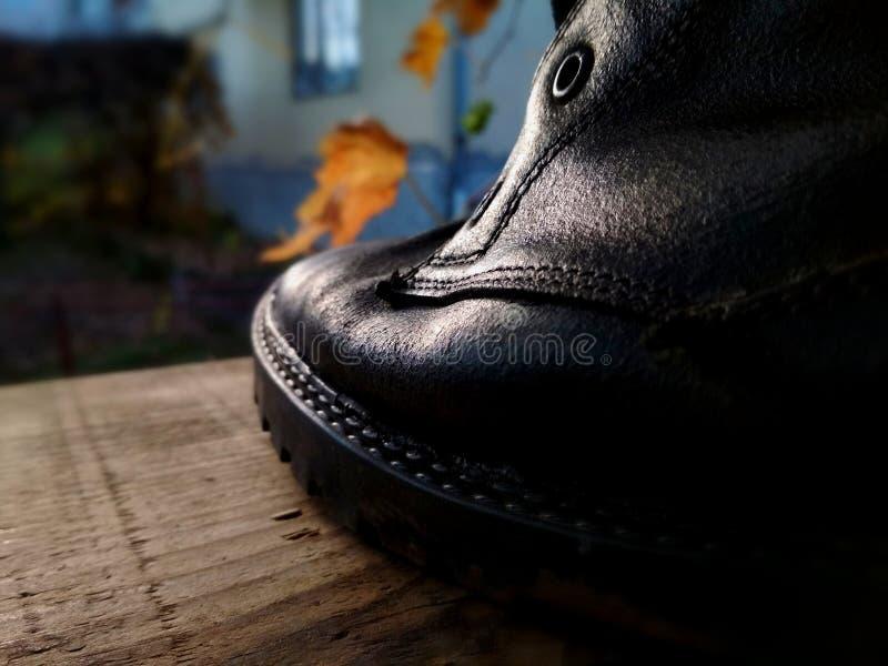 老黑皮鞋 免版税图库摄影