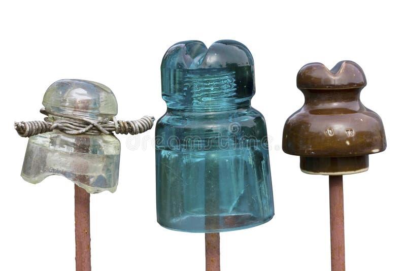 老玻璃和陶瓷绝缘体 免版税库存图片