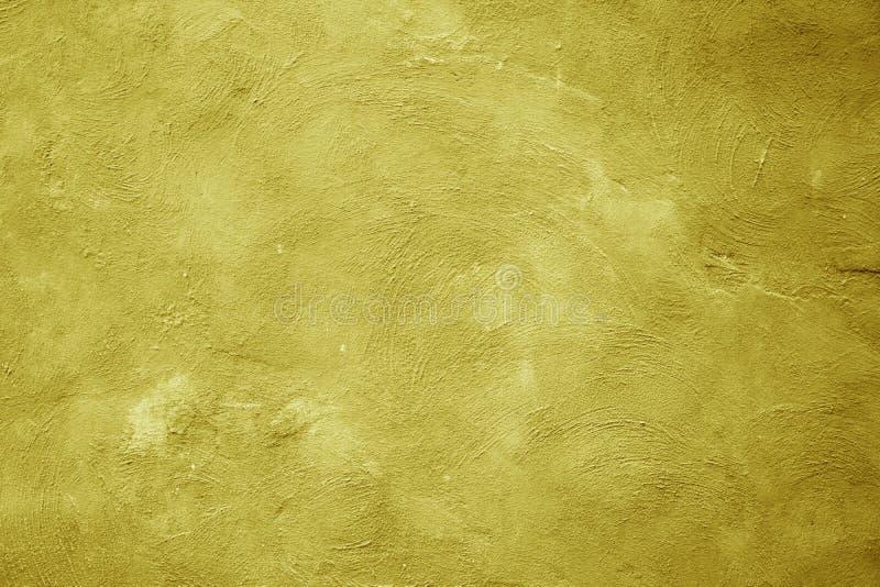 老黄色墙壁被抓的纹理背景 免版税库存图片