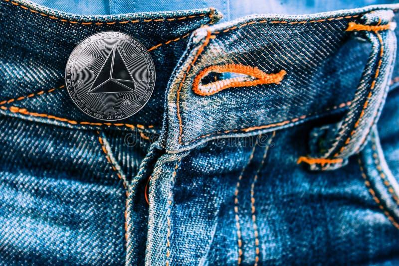 而不是按钮的Trx硬币在牛仔裤 库存照片