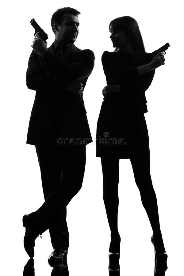 耦合妇女人侦探侦探罪犯剪影 图库摄影