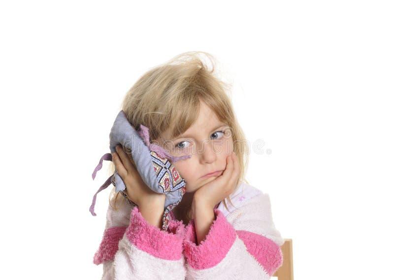 耳朵痛女孩有一点 免版税库存图片