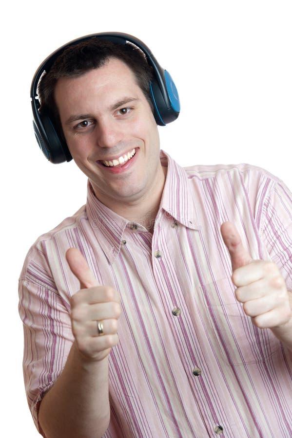 耳机人赞许年轻人 免版税库存照片