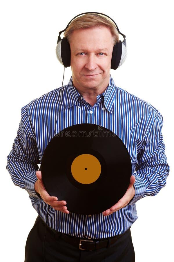 耳机供以人员老记录 库存图片