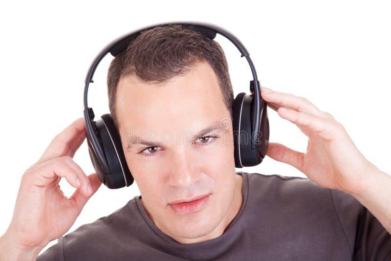 耳机听的人音乐 免版税库存照片