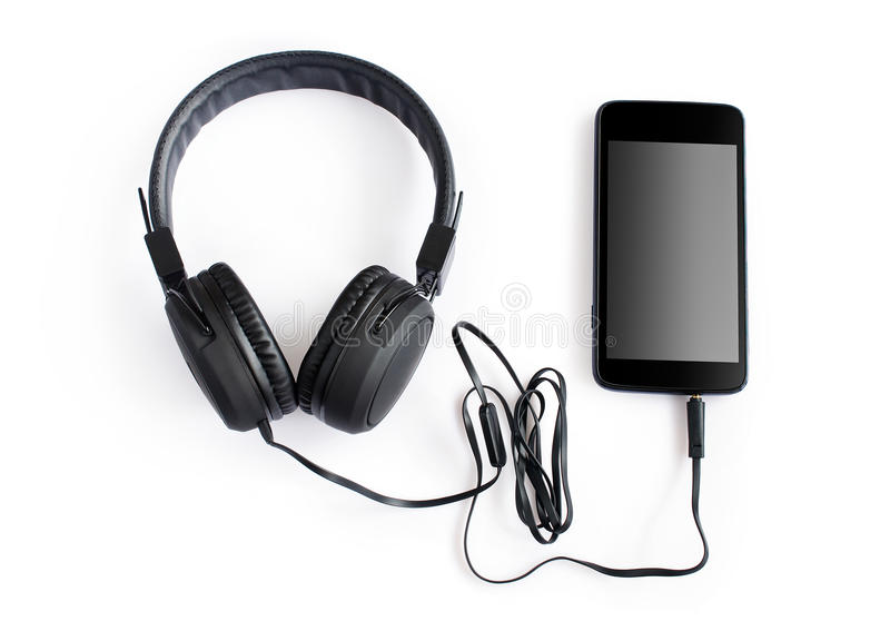 耳机和智能手机 免版税库存照片