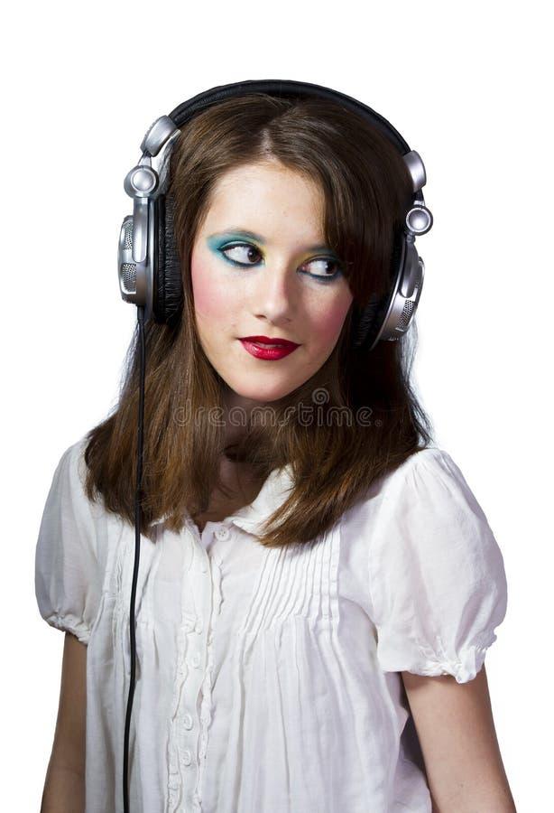 耳机女孩年轻人 免版税库存照片
