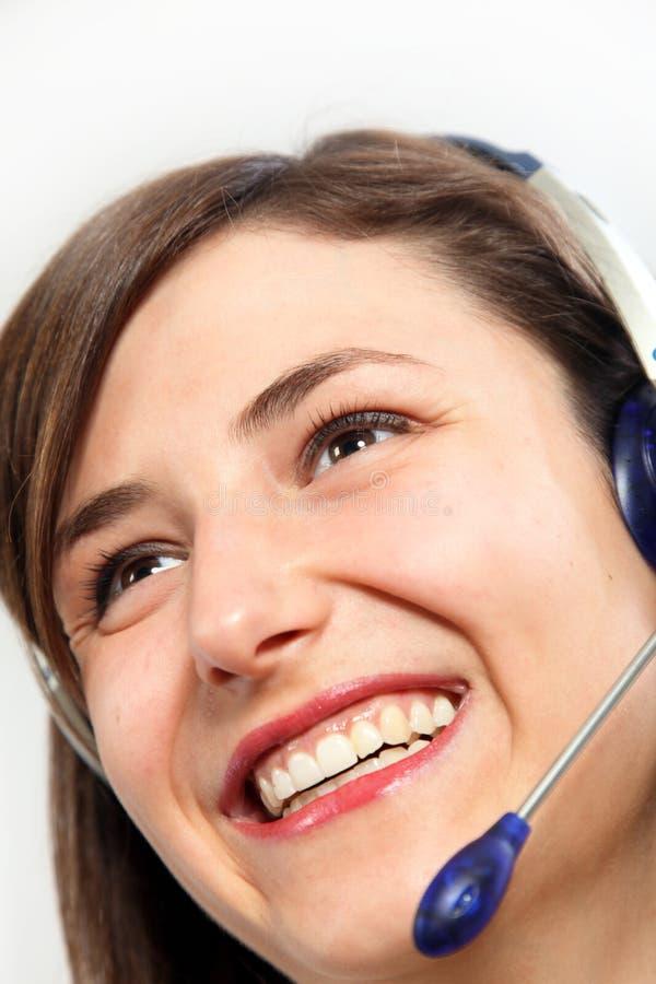 耳机微笑的妇女 图库摄影