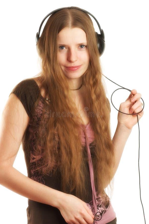 耳机的妇女 免版税库存图片
