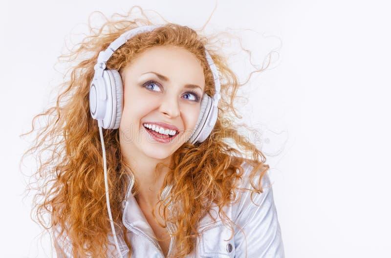 耳机的妇女 免版税图库摄影