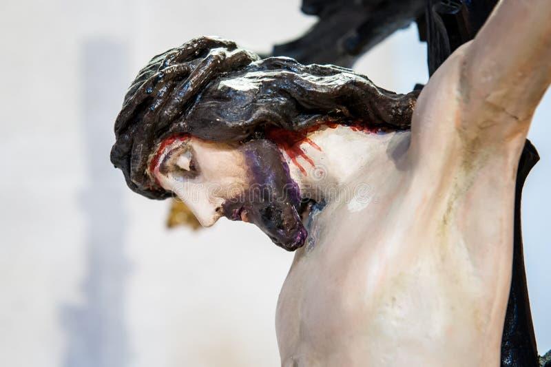 耶稣基督特写镜头在十字架迫害死 免版税库存图片