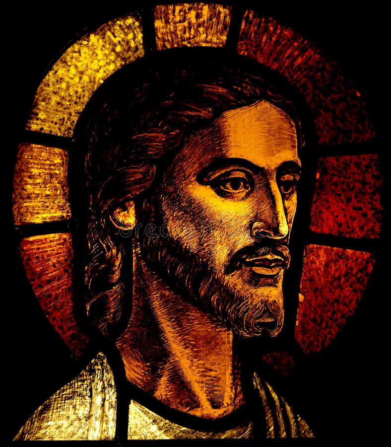 耶稣基督头彩色玻璃的 库存图片