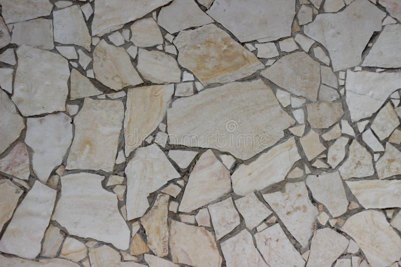 耶路撒冷石头纹理米黄块老马赛克墙壁  库存图片