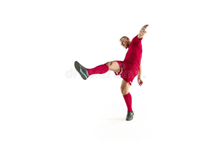 职业橄榄球在白色背景隔绝的足球运动员 免版税库存照片