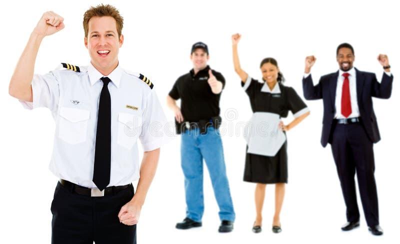 职业:与雇员小组的飞行员欢呼 免版税库存图片