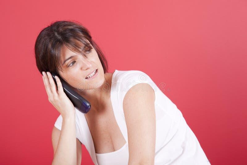 联系的电话妇女 免版税库存照片