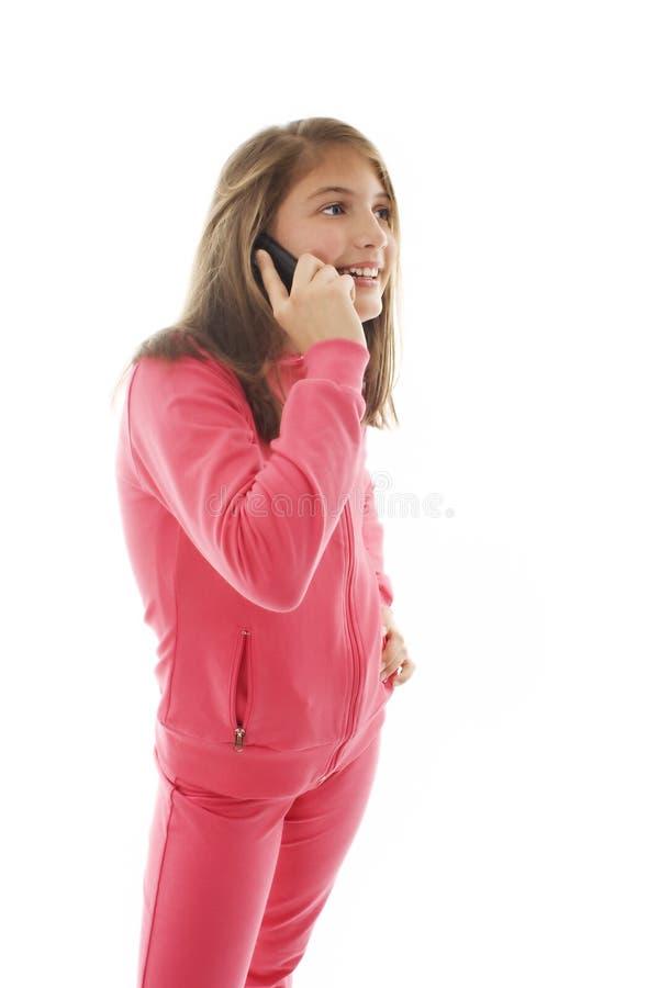 联系移动电话逗人喜爱的女孩少年年&# 免版税图库摄影