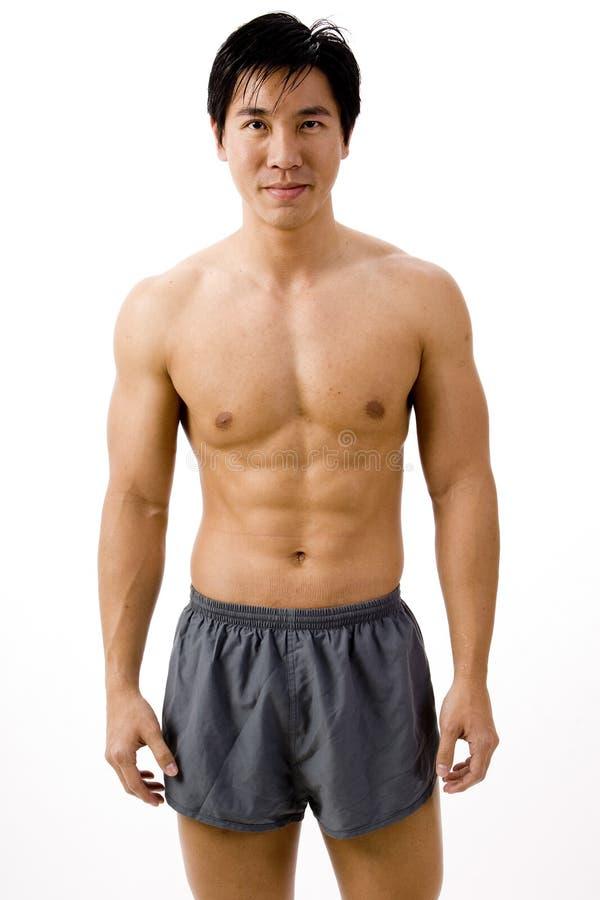 肌肉亚洲人 库存图片