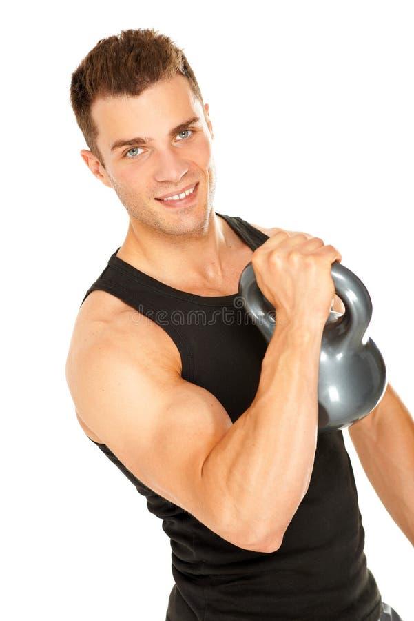 肌肉哑铃增强的人 免版税图库摄影