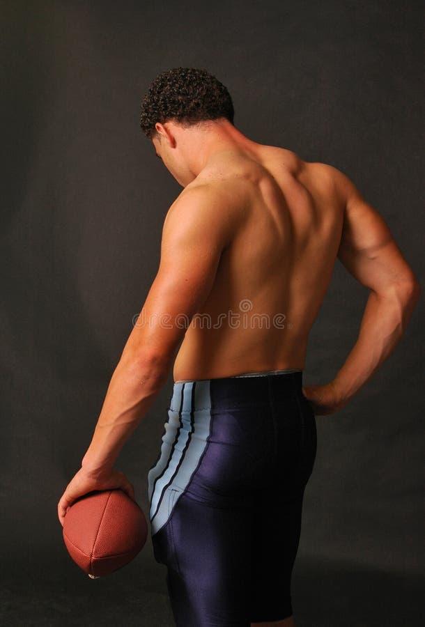 肌肉回到蓝色的橄榄球 免版税图库摄影
