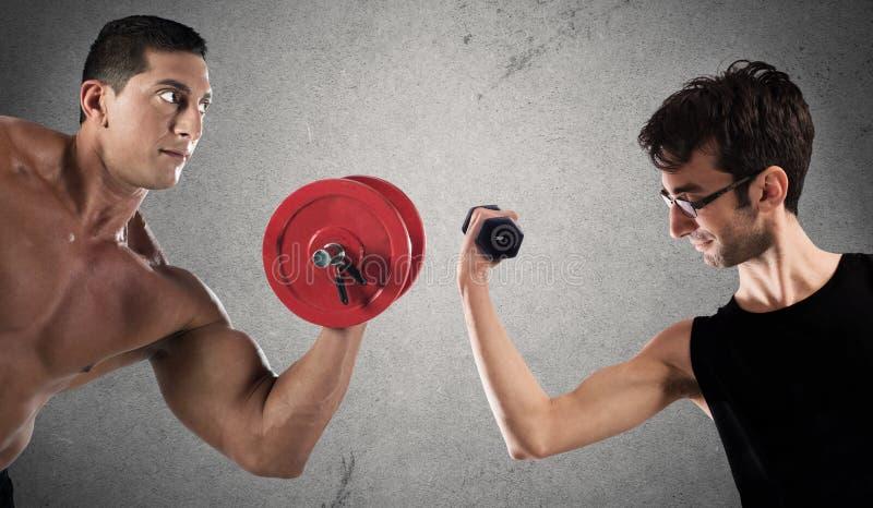 肌肉强度讽刺比较  图库摄影
