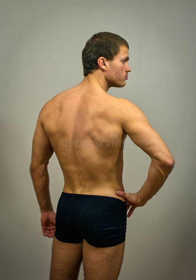 肌肉男性式样摆在 库存图片