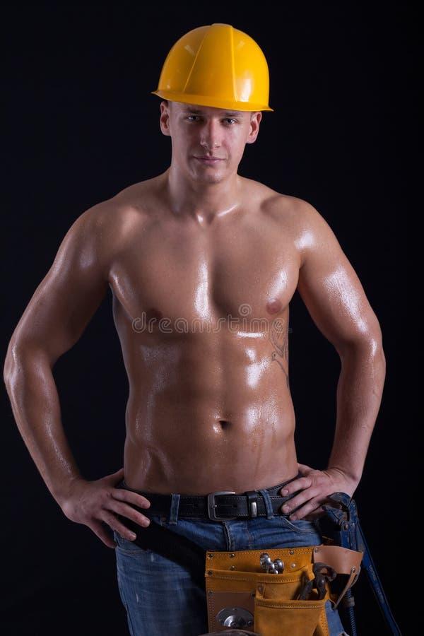 肌肉男性建筑工人 免版税库存图片