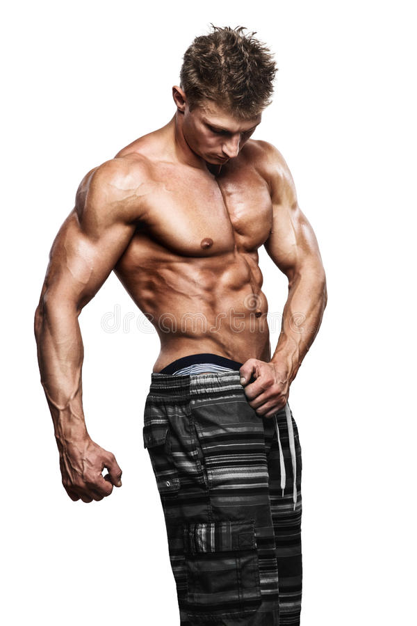 肌肉英俊性感人摆在 免版税图库摄影