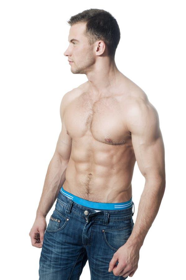 肌肉运动员运动的年轻人 库存图片