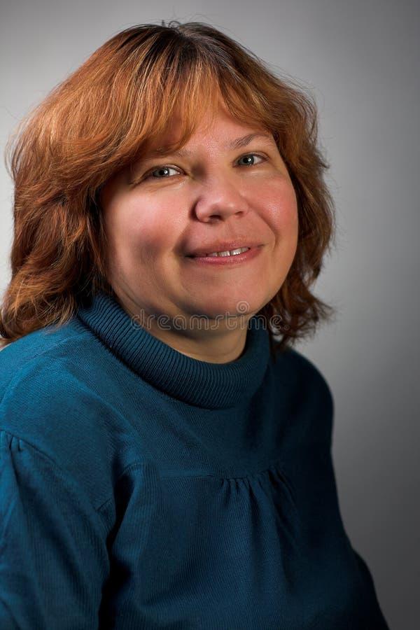 肥胖微笑的妇女 库存图片
