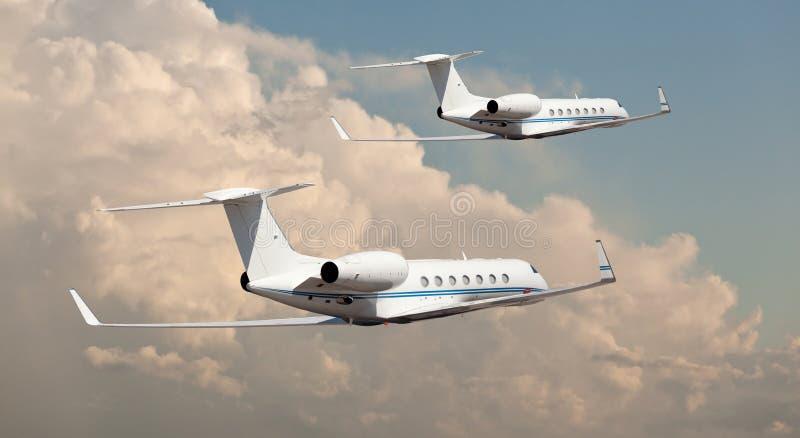 肩并肩飞行两个的私人喷气式飞机 图库摄影