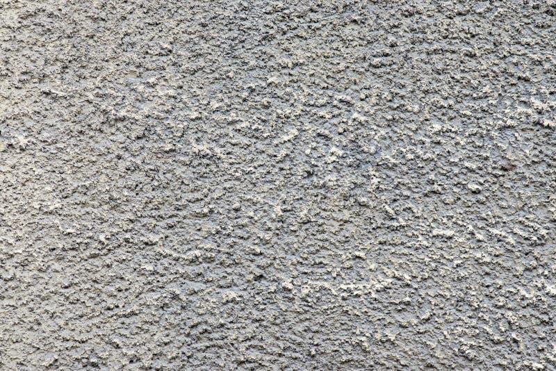 肮脏的灰色颜色七高八低的纹理水泥墙壁  免版税库存照片