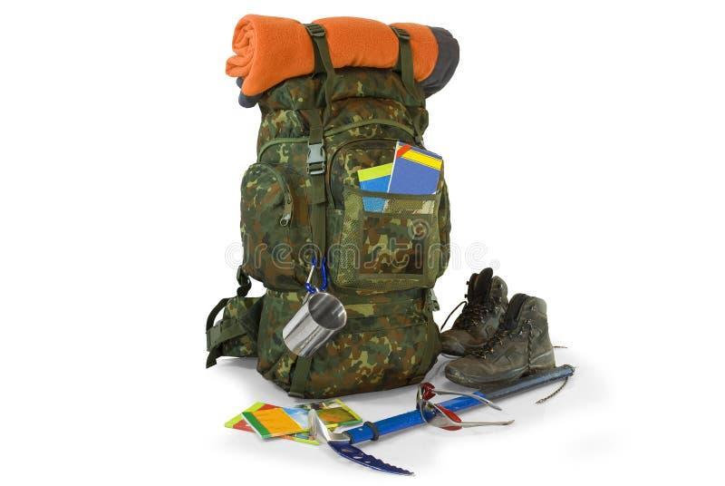 背包用在白色的旅游设备 免版税图库摄影