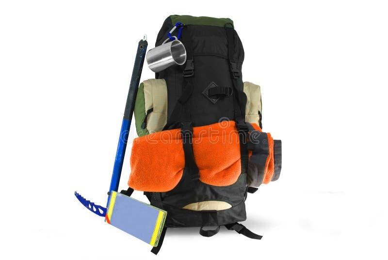背包用在白色的旅游设备 免版税库存图片