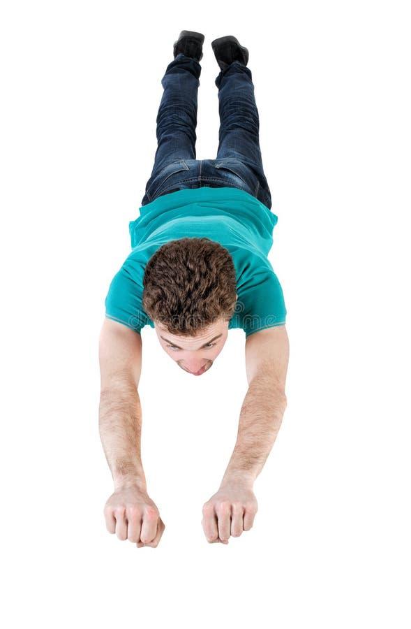 背景下来落的飞行人天空年轻人 免版税库存图片