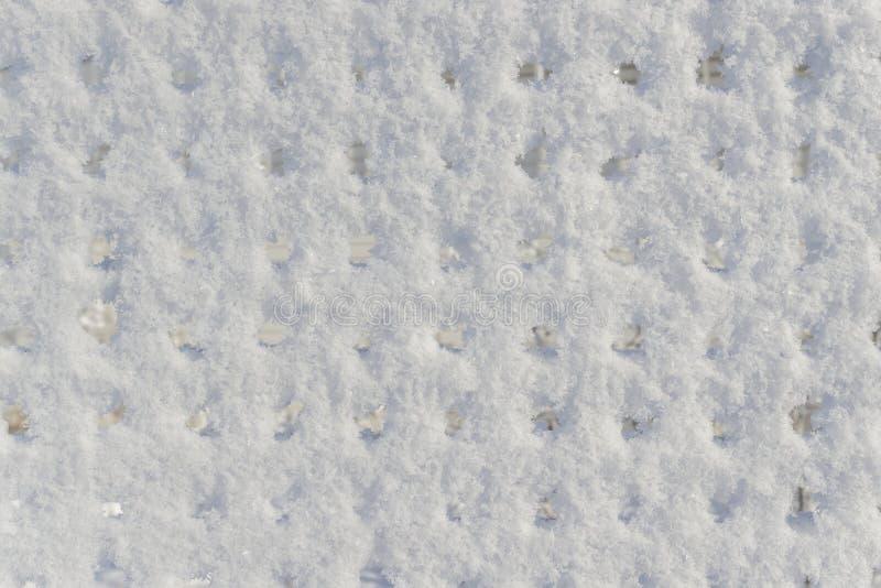 背景不均匀的雪表面 库存图片
