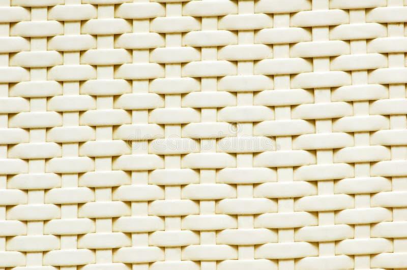 背景做被编织的塑料数据条 库存图片