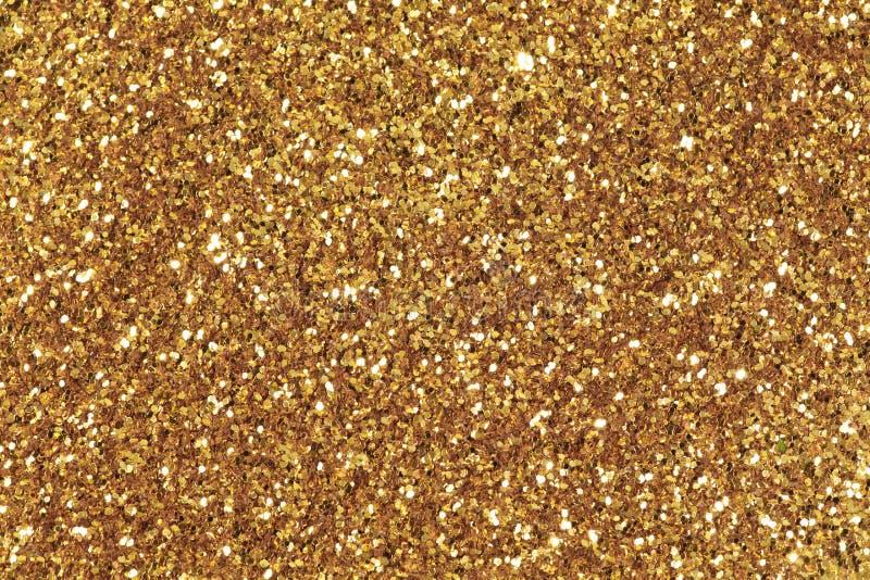 背景充满发光的金子闪烁 免版税图库摄影