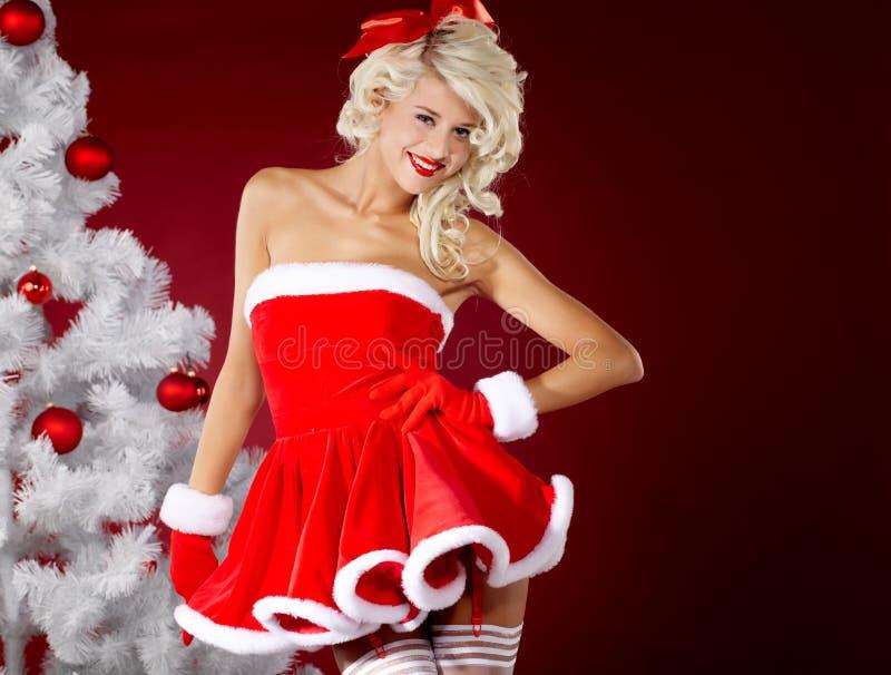 背景在红色圣诞老人诉讼的克劳斯女&# 库存图片