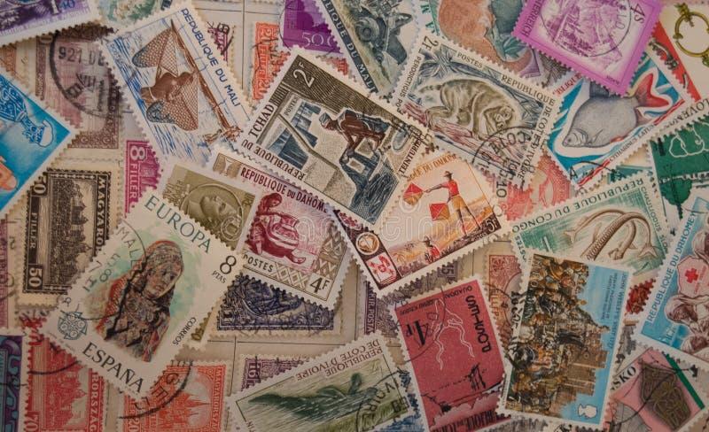 背景或横幅的老邮票 图库摄影