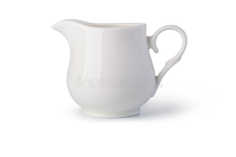 背景接近的颜色金子查出白色的水罐牛奶 图库摄影